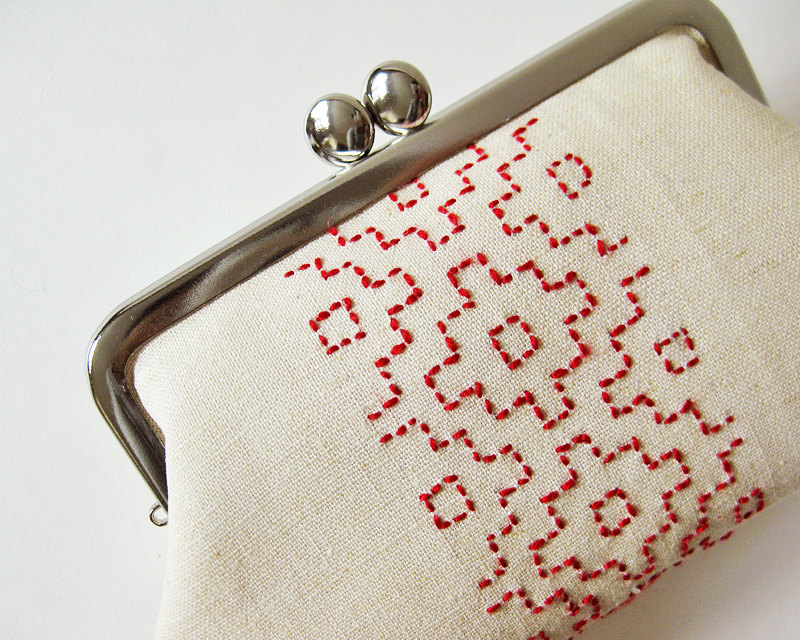 Red sashiko on ecru kiss lock purse by Oktak